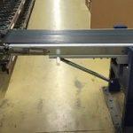 Conveyor band med gasfjäder